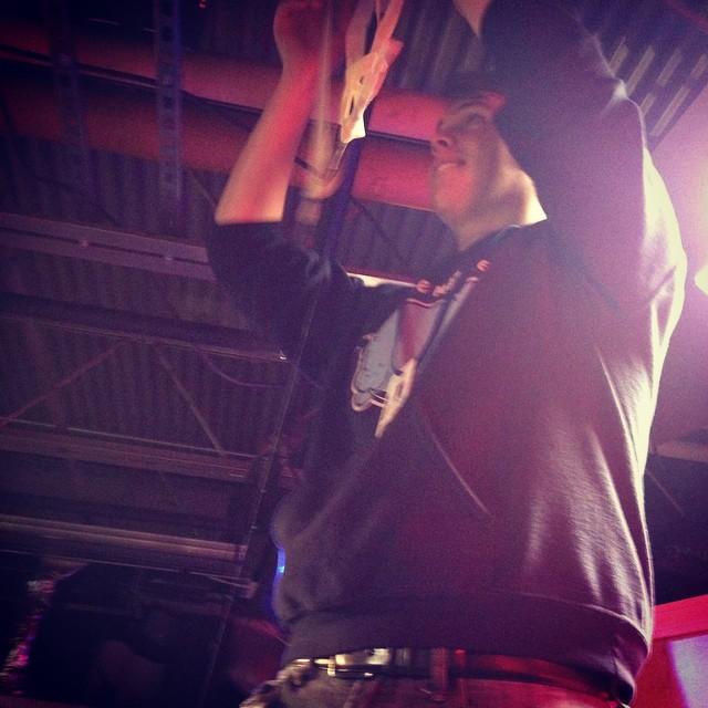 Set designer Caleb Dalton adjusts lighting and props for The Buzz.