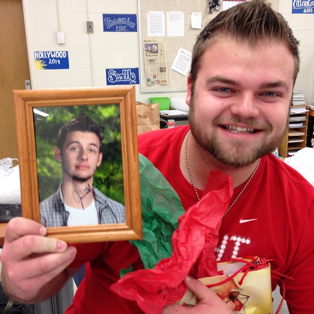 Jordan Lundquist is a good sport after opening his gift and finding this was inside: a photo of fellow HTVer James McCullough.