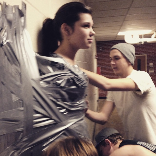 Cailey Melville tries to remain calm as Colten Hames helps duct tape her to the wall. A Buzz-A-Thon tradition.